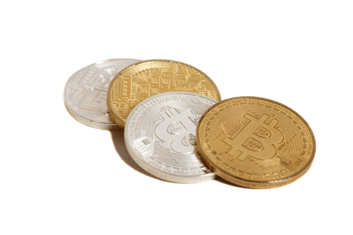 Physical bitcoin coins made of gold and silver